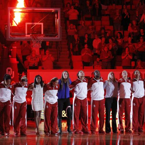 The women's team stands in line as players are introduced as the University of Oklahoma Sooners (OU) play the Kansas Jayhawks in NCAA, women's college basketball at The Lloyd Noble Center on Saturday, Feb. 22, 2014 in Norman, Okla. Aaryn Ellenberg is in street clothes fifth from left. Photo by Steve Sisney, The Oklahoman