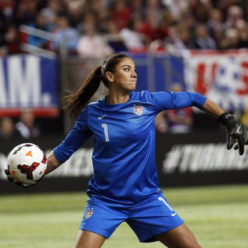 USA goalkeeper Hope Solo clears the ball in the first half of an exhibition soccer match against Russia, Thursday, Feb. 13, 2014, in Atlanta. (AP Photo/John Bazemore)
