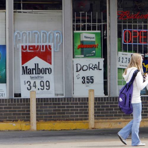 A student walks past cigarette and beer sign in a convenience store near her school on north May, Friday, March 28, 2008. Photo by DAVID MCDANIEL, THE OKLAHOMAN
