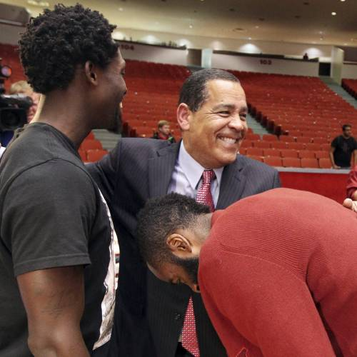 New Houston NCAA college basketball coach Kelvin Sampson, center, is congratulated by Houston Rockets Patrick Beverley, left, and James Harden during a news conference Thursday April 3, 2014, in Houston, Texas. Houston introduced the former assistant Rockets coach confident that he can bring the once-proud program back to prominence and undeterred by his past improprieties with the NCAA. (AP Photo/Houston Chronicle, Billy Smith II)