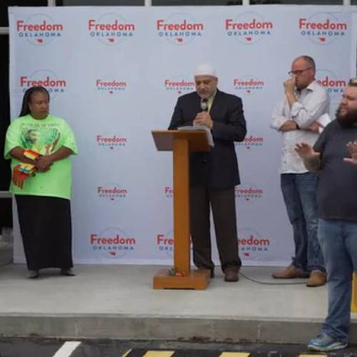 Imad Enchassi, at podium, speaks at a Freedom Oklahoma prayer vigil on June 12, held in the...