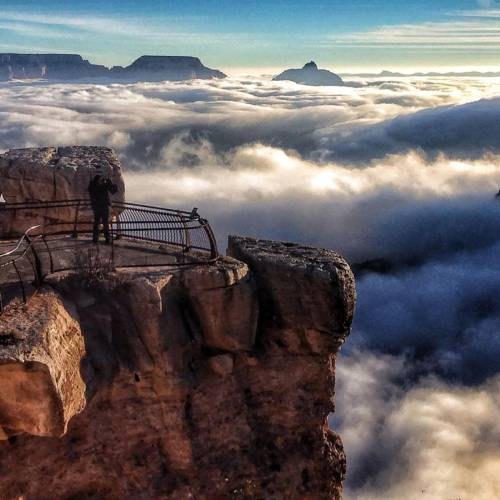 AP10ThingsToSee - In this photo released by the National Park Service, visitors to Mather Point at Grand Canyon National Park, Ariz. look out over a rare total cloud inversion, Friday Nov. 29, 2013. The phenomenon, caused by cold and warm air masses interacting, left the Grand Canyon peaking above a sea of clouds. (AP Photo/National Park Service, Erin Whittaker, File)