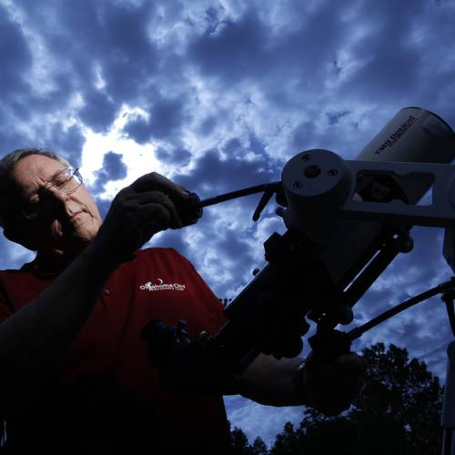 Mike Brake, a member of the Oklahoma City Astronomy Club, demonstrates his telescope at the...