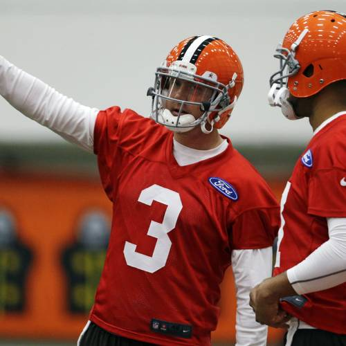 Cleveland Browns quarterback Brandon Weeden (3) talks with quarterback Jason Campbell during NFL football mini-camp at the team's training facility, Tuesday, April 16, 2013, in Berea, Ohio. Weeden and Campbell threw passes side-by-side as the Browns opened their first mini-camp of the season. The 29-year-old Weeden is the incumbent and started 15 games last year. He was the 22nd overall pick in the 2012 draft. Campbell, 31, was signed as a free agent on March 26. The ninth-year pro appeared in six games last season with the Bears. (AP Photo/Tony Dejak) ORG XMIT: OHTD103