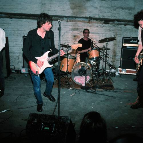 MINNEAPOLIS - DECEMBER 15: The Replacements (L-R) Tommy Stinson-Bass, Paul Westerberg-Vocals/Guitar, Steve Foley-Drums, Slim Dunlap-Guitar perform for Warner Bros Records staff and friends in the basement of Metro Studios in Minneapolis, Minnesota on December 15, 1990. (Photo by Jim Steinfeldt/Michael Ochs Archives/Getty Images)