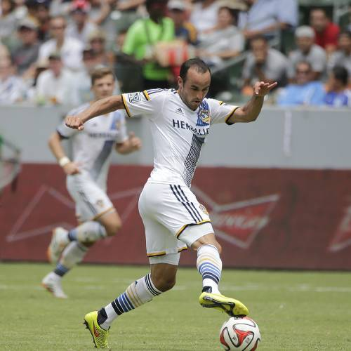 In this Saturday, Aug. 2, 2014 photo, Los Angeles Galaxy's Landon Donovan controls the ball during the second half of an MLS soccer match against Portland Timers in Carson, Calif. Donovan says he will retire from professional soccer at the end of the MLS season. (AP Photo/Jae C. Hong)