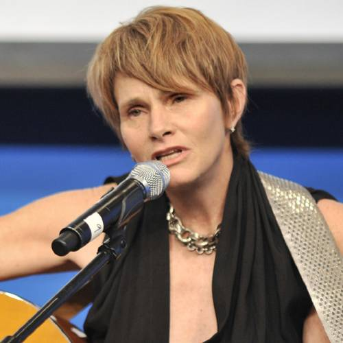 Shawn Colvin plays a Leonard Cohen song after as Cohen was honored at the John F. Kennedy Presidential Library and Museum in Boston, Sunday, Feb. 26, 2012. Cohen and Chuck Berry were awarded the first PEN New England Awards for Song Lyrics of Literary Excellence at the event, which was attended by Keith Richards, Elvis Costello, and Paul Simon. (AP Photo/Josh Reynolds)