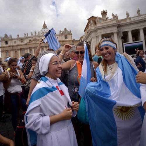 Nuns pose with the jersey of Argentinian football star Lionel Messi and flags prior Pope Francis Sunday Angelus prayer at St. Peter's Square on July 13, 2014 at the Vatican. Argentina will face Germany today for the FIFA World Cup Brazil 2014 final. AFP PHOTO / FILIPPO MONTEFORTE (Photo credit should read FILIPPO MONTEFORTE/AFP/Getty Images)