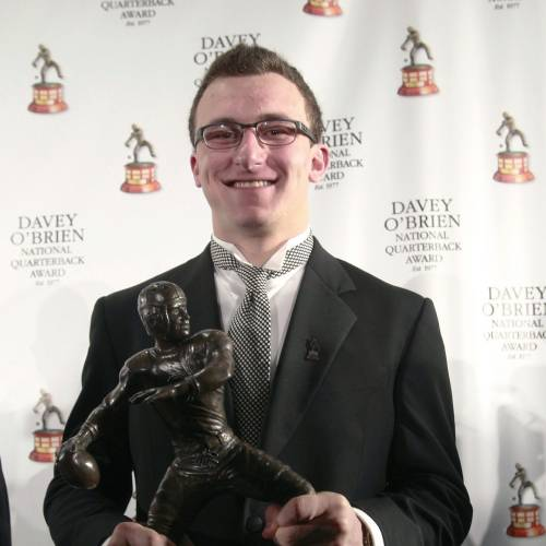 Texas A&M quarterback Johnny Manziel, winner of the Davey O'Brien Award, poses with the trophy during a news conference at the Fort Worth Club, Monday, Feb. 18, 2013 in Fort Worth, Texas. The award is given to the nation's top NCAA college football quarterback. (AP Photo/The Fort Worth Star-Telegram, Rodger Mallison) ORG XMIT: TXFOR102