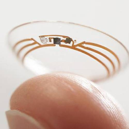 This undated photo released by Google shows a contact lens Google is testing to explore tear glucose. After years of scalding soldering hair-thin wires to miniaturize electronics, Brian Otis, Google X project lead, has burned his fingertips so often that he can no longer feel the tiny chips he made from scratch in GoogleÂ's Silicon Valley headquarters, a small price to pay for what he says is the smallest wireless glucose sensor that has ever been made. (AP Photo/Google)