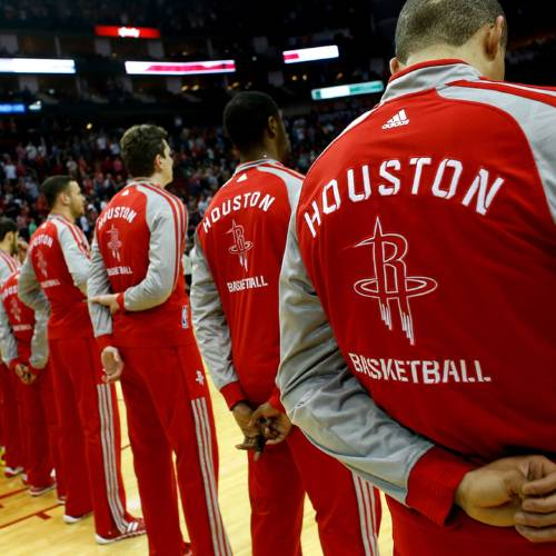 HOUSTON, TX - MARCH 29: Members of the Houston Rockets stand during the National Anthem before the game against the Los Angeles Clippers at the Toyota Center on March 29, 2014 in Houston, Texas. NOTE TO USER: User expressly acknowledges and agrees that, by downloading and or using this photograph, User is consenting to the terms and conditions of the Getty Images License Agreement. (Photo by Scott Halleran/Getty Images)