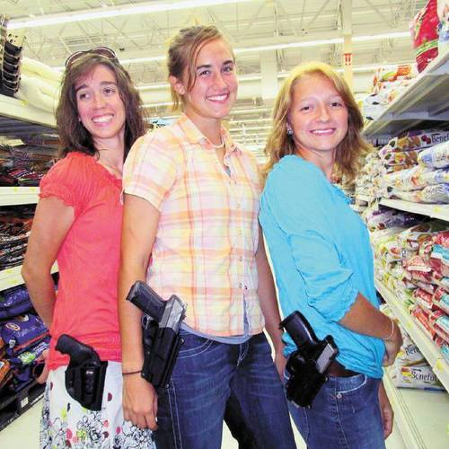 In this courtesy photo, (left to right) Qadoshyah Fish, vice chair of the Cherokee County Republican Party, Hannah Young and Suriyah Fish are licensed for open carry.