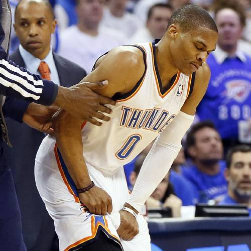 Oklahoma City's Russell Westbrook (0) reacts after being hurt in the second quarter during Game 2 in the first round of the NBA playoffs between the Oklahoma City Thunder and the Houston Rockets at Chesapeake Energy Arena in Oklahoma City, Wednesday, April 24, 2013. Photo by Nate Billings, The Oklahoman