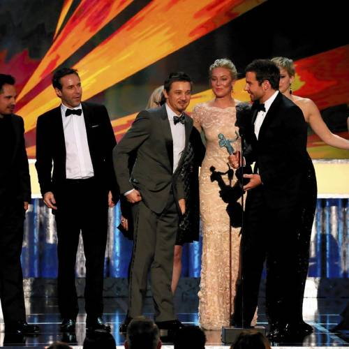 LOS ANGELES, CA - January 18, 2014 - Bradley Cooper, holding the statuette, on stage with American Hustle ensemble, accepting the SAG Award for A Cast In Motion Picture at the 20th Annual Screen Actors Guild Awards at the Shrine Auditorium in Los Angeles, CA on Saturday, January 18, 2014 (Robert Gauthier / Los Angeles Times)
