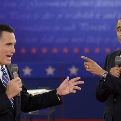 FILE - In this Oct. 16, 2012 file photo, President Barack Obama and Republican presidential candidate, former Massachusetts Gov. Mitt Romney exchange views during the second presidential debate at Hofstra University in Hempstead, N.Y. (AP Photo/David Goldman, File)