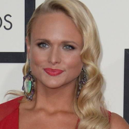Miranda Lambert arrives on the red carpet for the 56th Grammy Awards at the Staples Center in Los Angeles, California, January 26, 2014. AFP PHOTO ROBYN BECK (Photo credit should read ROBYN BECK/AFP/Getty Images)