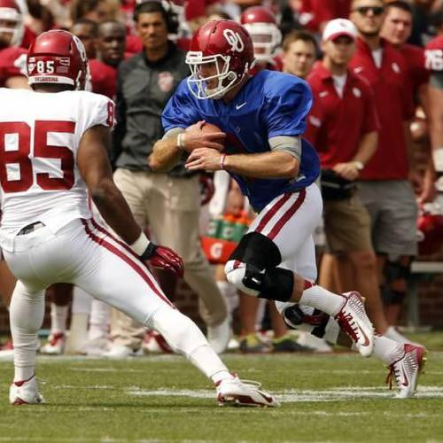 Trevor Knight runs and Geneo Grissom defends during the OU Spring Game at Gaylord Family-Oklahoma Memorial Stadium in Norman on April 12. Photo by Steve Sisney, The Oklahoman