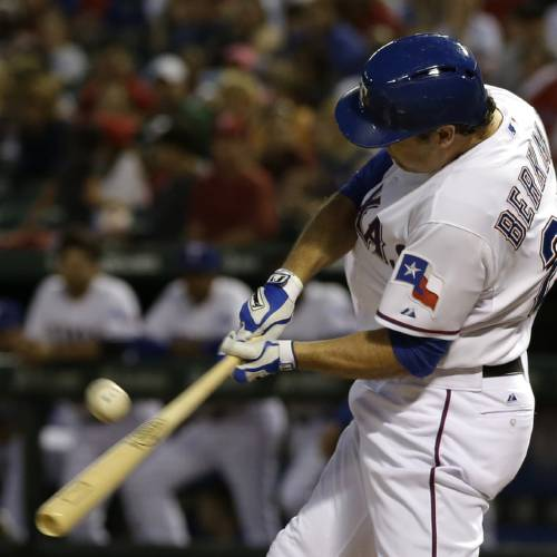Texas Rangers' Lance Berkman (27) follows through on a soft fly to center that scored Ian Kinsler and Leonys Martin in the third inning of a baseball game off a pitch from Tampa Bay Rays' Roberto Hernandez Tuesday, April 9, 2013, in Arlington, Texas. (AP Photo/Tony Gutierrez) ORG XMIT: ARL104