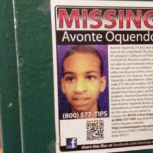 In this Oct. 21, 2013 file photo, a missing poster asking for help in finding Avonte Oquendo is displayed at a subway station in the Brooklyn borough of New York. Oquendo, 14, who is autistic, was last seen on Oct. 4 walking out of his Queens school. Avonte was in a school building that like many in the city had special-needs and general-education students together under one roof. He was outwardly indistinguishable from everybody else, leading some parents and advocates to question whether the nation's largest school system is equipped to keep such kids safe. (AP Photo/Barbara Woike)