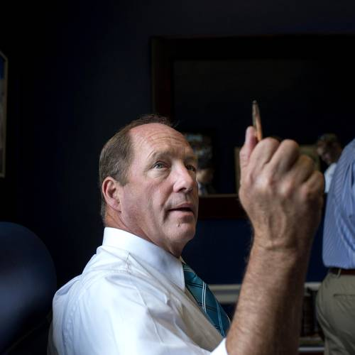 WASHINGTON, DC - OCTOBER 3: Tea Partier and veterinarian Freshman CongressmanTed Yoho (R-FL) works with staff in his office on Capitol Hill Thursday October 3, 2013. Rep. Yoho a loud and influential voice for an outsider in the Republican Conference of the House during the budget debate. (Photo by Melina Mara/The Washington Post)