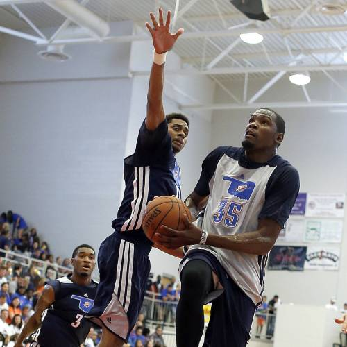 Oklahoma City's Kevin Durant (35) shoots a lay up as Jeremy Lamb (11) defends during the Oklahoma City Thunder's Blue and White scrimmage at Westmoore High School in Moore, Okla., Sunday, Oct. 13, 2013. Photo by Sarah Phipps, The Oklahoman