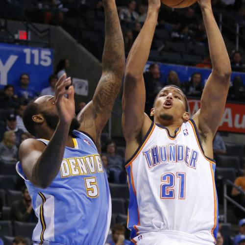 Oklahoma City 's Andre Roberson (21) drives beside Denver's Damion James (5) during an NBA preseason game between the Oklahoma City Thunder and the Denver Nuggets at Chesapeake Energy Arena on Tuesday, october 15, 2013. Tuesday, Oct. 15, 2013. Photo by Bryan Terry, The Oklahoman