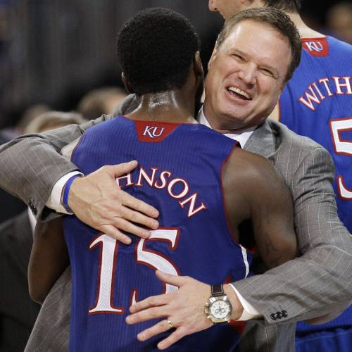 Kansas coach Bill Self celebrates with guard Elijah Johnson during the second half of the NCAA men's college basketball tournament Midwest Regional final against North Carolina on Sunday, March 25, 2012, in St. Louis. Kansas won 80-67. (AP Photo/Charlie Riedel)