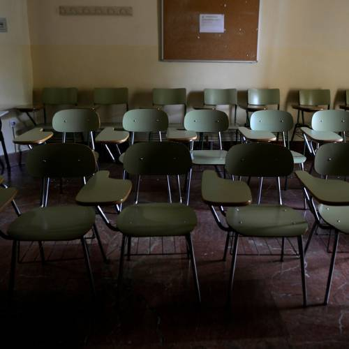 A picture taken on October 31, 2012 shows empty chairs in a classroom of the University of Seville, in Sevilla. AFP PHOTO / CRISTINA QUICLER (Photo credit should read CRISTINA QUICLER/AFP/Getty Images)