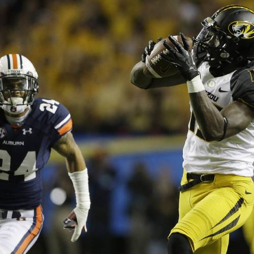 Missouri wide receiver Dorial Green-Beckham (15) prepares to run into the end zone against Auburn defensive back Jermaine Whitehead (9) during the first half of the Southeastern Conference NCAA football championship game, Saturday, Dec. 7, 2013, in Atlanta. (AP Photo/John Bazemore)