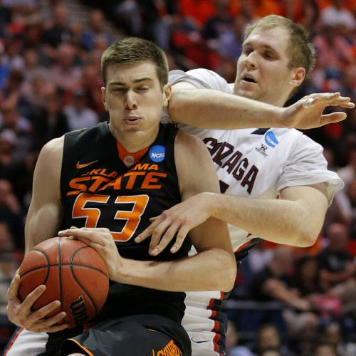 Oklahoma State's Mason Cox (53) grabs a rebound in front of Gonzaga's Przemek Karnowski (24) during a second round game of the NCAA men's college basketball tournament at Viejas Arena in San Diego, between Oklahoma State and Gonzaga Friday, March 21, 2014. Gonzaga won 85-77. Photo by Bryan Terry, The Oklahoman
