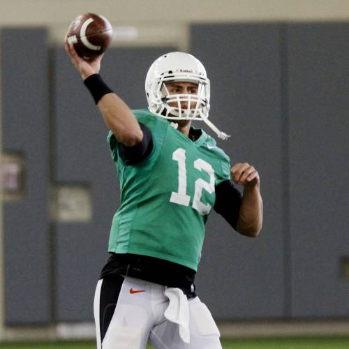 """Oklahoma State quarterback Daxx Garman throws a pass during practice on Tuesday, April 1, 2014, at the outside fields of the Sherman E. Smith training facility of Oklahoma State University in Stillwater. The Cowboys' will hold """"Orange Blitz"""", an open practice that will replace the annual spring game this Saturday. Photo by KT King/For the Oklahoman"""