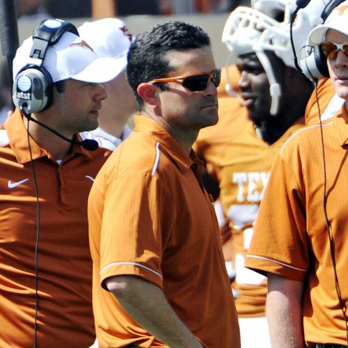 FILE - In this April 1, 2012 file photo, Texas defensive coordinator Manny Diaz watches during the Orange and White spring NCAA college football game, in Austin, Texas. Texas fired defensive coordinator Manny Diaz on Sunday, Sept. 8, 2013, less than 24 hours after one of the worst defensive performances in the history of the program. Longhorns coach Mack Brown announced that former Longhorns defensive coordinator and Syracuse coach Greg Robinson will take over the job. (AP Photo/Michael Thomas, File)