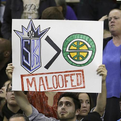 In this Jan. 10, 2013, file photo, Sacramento Kings fan Gerald McDaniel displays his feelings toward the Maloof family, owners of the team before an NBA basketball game against the Dallas Mavericks in Sacramento, Calif. After backing out of the deal to build a new arena in Sacramento and announcing the sale of the Kings to a group that wants to move the team to Seattle, the brothers have become the city's most-reviled villains heading into a preliminary NBA meeting on the issue Wednesday, April 3, 2013, in New York. (AP Photo/Rich Pedroncelli, File)