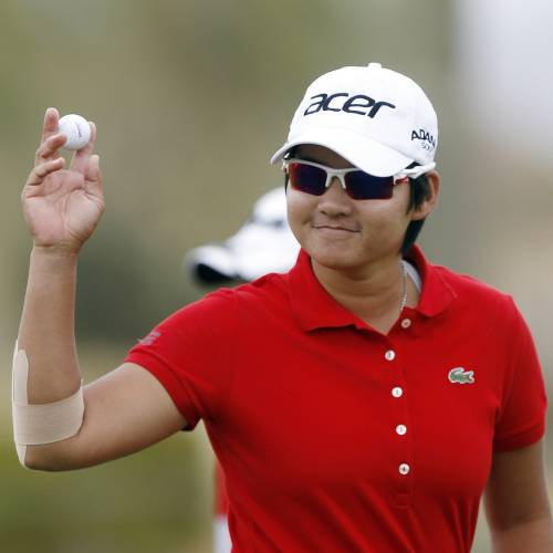In this March 17, 2012 file photo, Yani Tseng, of Taiwan, waves to the crowd after making par on the ninth hole during the third round of the Founder's Cup golf tournament in Phoenix. (AP Photo/Paul Connors, File)
