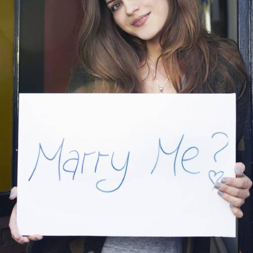 woman holding sign saying