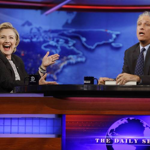 "Former U.S. Secretary of State Hillary Rodham Clinton reacts to host Jon Stewart during a taping of ""The Daily Show with Jon Stewart,"" Tuesday, July 15, 2014, in New York. (AP Photo/Frank Franklin II) ** Usable by LA, DC, CGC and CCT Only **"