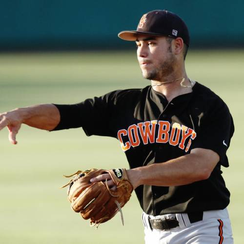 Oklahoma State second baseman Tim Arakawa (2) throws to first base during an NCAA Regional Baseball game between the Oklahoma State and Cal State Fullerton at Allie P. Reynolds stadium in Stillwater on May 31, 2014. Photo by KT King/The Oklahoman