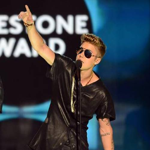 """LAS VEGAS, NV - MAY 19: Singer Justin Bieber accepts the """"Milestone"""" award onstage during the 2013 Billboard Music Awards at the MGM Grand Garden Arena on May 19, 2013 in Las Vegas, Nevada. (Photo by Ethan Miller/Getty Images)"""