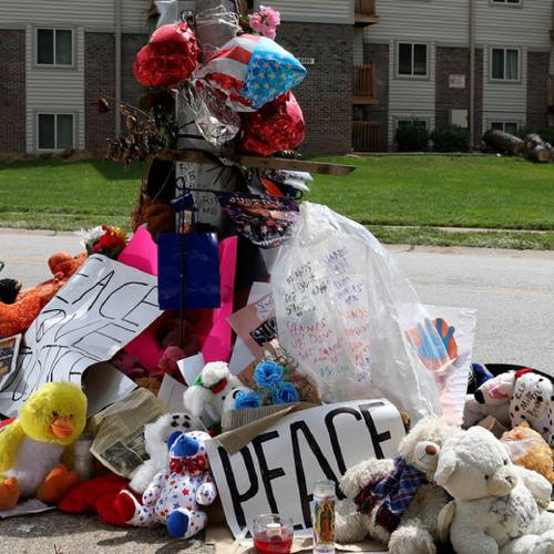 FERGUSON, MO - AUGUST 22: A memorial setup for Michael Brown is seen near the spot where his body lay after he was shot by police on August 22, 2014 in Ferguson, Missouri. Protesters have been vocal asking for justice in the shooting death of Michael Brown by a Ferguson police officer on August 9th. (Photo by Joe Raedle/Getty Images)
