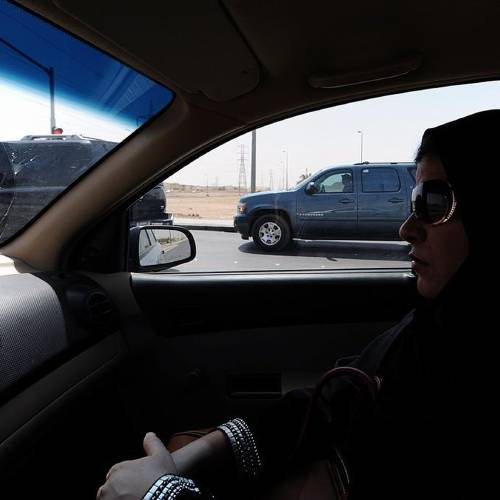 """A Saudi woman sits in a vehicle as a passenger on September 22, 2013 in Riyadh. Saudi women activists have called for a new day of defiance next month of the longstanding ban on women driving in the ultra-conservative kingdom. An online petition entitled """"Oct 26th, driving for women"""" had on Sunday gathered more than 5,800 signatories, as activists try again to push authorities to end the unique ban. AFP PHOTO/FAYEZ NURELDINEFAYEZ NURELDINE/AFP/Getty Images"""