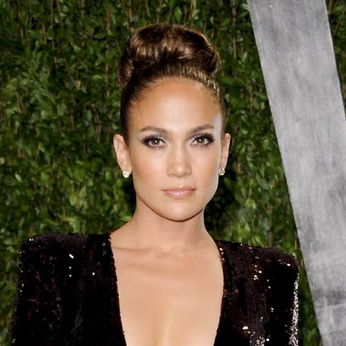 In this Feb. 26, 2012 file photo, actress and singer Jennifer Lopez arrives at the Vanity Fair Oscar party in West Hollywood, Calif. Lopez announced in a statement Monday, March 26, that she would be performing at the Pop Music Festival in Sao Paulo on June 23 and in Rio De Janeiro on June 27. (AP Photo/Evan Agostini)