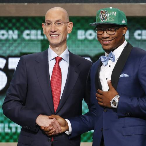 Oklahoma State's Marcus Smart, right, poses for a photo with NBA commissioner Adam Silver after being selected sixth overall by the Boston Celtics during the 2014 NBA draft, Thursday, June 26, 2014, in New York. (AP Photo/Jason DeCrow)