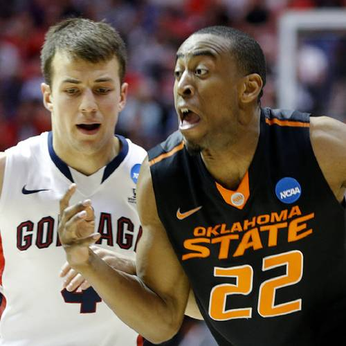 Oklahoma State's Markel Brown (22) tries to get past Gonzaga's Kevin Pangos (4) during a second round game of the NCAA men's college basketball tournament at Viejas Arena in San Diego, between Oklahoma State and Gonzaga Friday, March 21, 2014. Photo by Bryan Terry, The Oklahoman