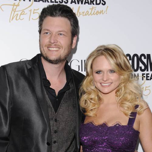 """FILE - This March 5, 2012 file photo shows country singers Blake Shelton, left, and his wife, Miranda Lambert at Cosmopolitan Magazine's """"Fun Fearless Males and Females of 2012"""" awards in New York. Shelton's """"Mine Would Be You"""" and Miranda Lambert's """"Mama's Broken Heart"""" are both nominated for a Grammy award for best country solo performance. (AP Photo/Evan Agostini, file)"""