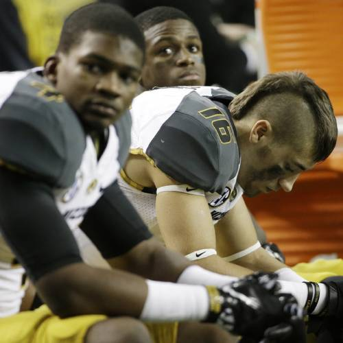 Missouri wide receiver Levi Copelin (16) sits on the bench after the second half of the Southeastern Conference NCAA football championship game against Auburn, Saturday, Dec. 7, 2013, in Atlanta. Auburn won 59-42. (AP Photo/David Goldman)