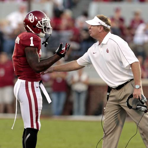 "OU defensive coordinator Mike Stoops, right, talks with Tony Jefferson during action against Kansas this past season. According to a WalterFootball.com draft scouting report, OU coaches have told NFL scouts that Jefferson, who has entered the NFL Draft, had ""horrible practice habits and a lack of work ethic in the weight room."" Photo by Steve Sisney, The Oklahoman"