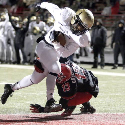 Broken Arrow's Devon Thomas gets by Mustang's Jordan Greenspan during the Class 6A football playoff game between Mustang and Broken Arrow at Mustang High School in Mustang, Okla., Friday, Nov. 22, 2013. Photo by Sarah Phipps The Oklahoman