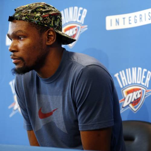 Kevin Durant listens to a question during exit interviews with the media for the Oklahoma City Thunder at the team's practice facility in Oklahoma City, Sunday, June 1, 2014. The Photo by Nate Billings, The Oklahoman