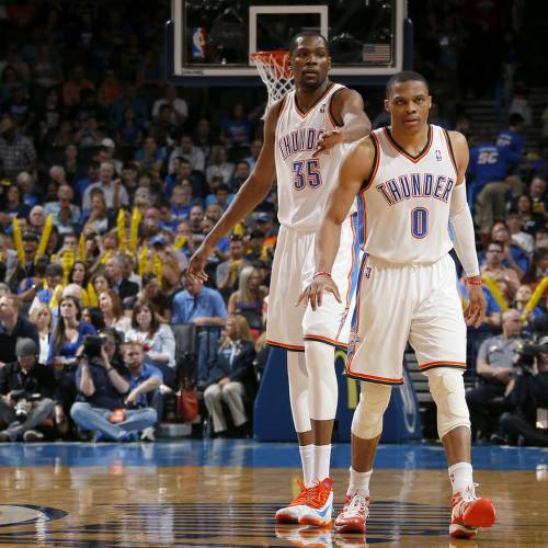Oklahoma City's Kevin Durant (35) and Russell Westbrook (0) get back on defense after a basket during an NBA basketball game between the Oklahoma City Thunder and the New Orleans Pelicans at Chesapeake Energy Arena in Oklahoma City, Friday, April 11, 2014. Oklahoma City won 116-94. Photo by Bryan Terry, The Oklahoman