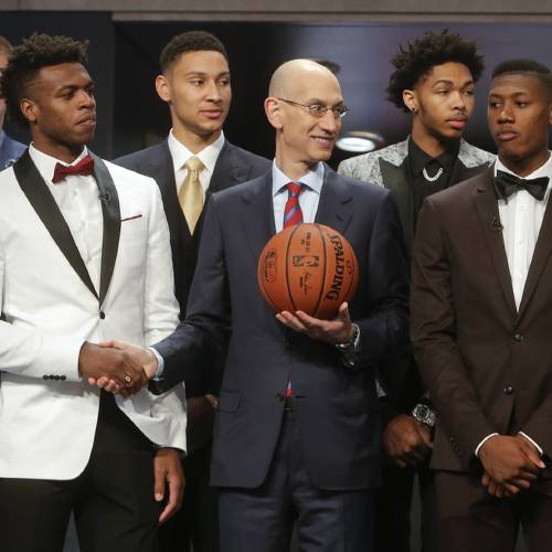 NBA Commissioner Adam Silver, center, poses for photos with former OU guard Buddy Hield, left,...